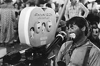 ca. 1978-1979, Pompano Beach, Florida, USA --- Jerry Lewis Sitting Next to Panavision Camera --- Image by © Owen Franken