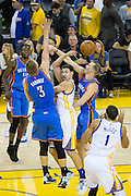 Golden State Warriors guard Klay Thompson (11) makes a no-look pass against the Oklahoma City Thunder at Oracle Arena in Oakland, Calif., on November 3, 2016. (Stan Olszewski/Special to S.F. Examiner)