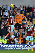 Wolverhampton Wanderers midfielder Dave Edwards beats Burnley midfielder David Jones to the header during the Sky Bet Championship match between Wolverhampton Wanderers and Burnley at Molineux, Wolverhampton, England on 7 November 2015. Photo by Alan Franklin.