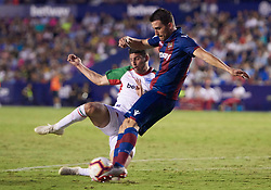 September 30, 2018 - Valencia, U.S. - VALENCIA, SPAIN - SEPTEMBER 30: Chema, defender of Levante UD competes for the ball with Jonathan Calleri of Deportivo Alaves during the La Liga match between Levante UD and Deportivo Alaves at Estadio Ciutat de Valencia on September 30, 2018, in Valencia, Spain. (Photo by Carlos Sanchez Martinez/Icon Sportswire) (Credit Image: © Carlos Sanchez Martinez/Icon SMI via ZUMA Press)