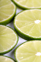 Lime slices on white background