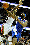Jan 31, 2010; Cleveland, OH, USA; Cleveland Cavaliers guard Daniel Gibson (1) tries to block Los Angeles Clippers guard Baron Davis (1) during the second quarter at Quicken Loans Arena. Mandatory Credit: Jason Miller-US PRESSWIRE