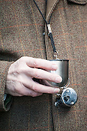 A fortifiying nip from a hip flask