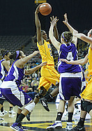 December 30, 2011: Iowa Hawkeyes guard Theairra Taylor (23) puts up a shot over Northwestern Wildcats forward Kendall Hackney (4) during the NCAA women's basketball game between the Northwestern Wildcats and the Iowa Hawkeyes at Carver-Hawkeye Arena in Iowa City, Iowa on Wednesday, December 30, 2011.