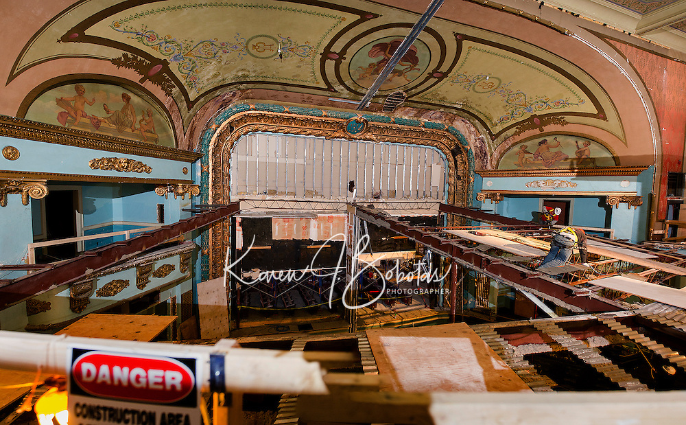 Bonnette, Page and Stone crews work on taking out the upper balcony bar joists in the Colonial Theater on Wednesday morning.  (Karen Bobotas/for the Laconia Daily Sun)