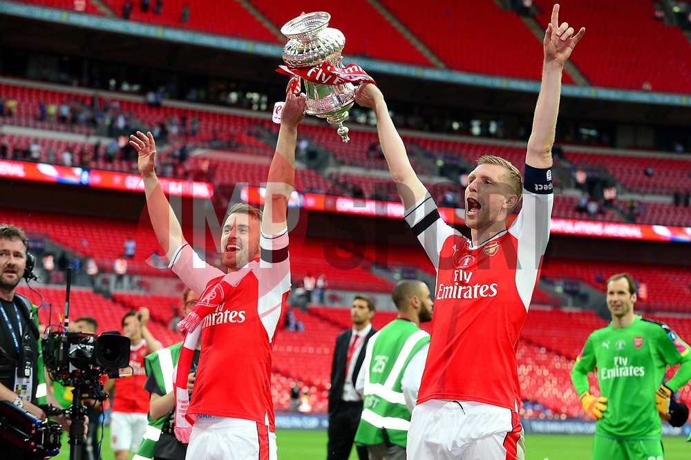 Aaron Ramsey and Per Mertesacker celebrate with the FA Cup after beating Chelsea 2-1  - Mandatory by-line: Dougie Allward/JMP - 27/05/2017 - FOOTBALL - Wembley Stadium - London, England - Arsenal v Chelsea - Emirates FA Cup Final