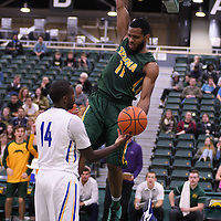 4th year forward Brian Ofori (11) of the Regina Cougars with the dunk during the home game on November  5 at Centre for Kinesiology, Health and Sport. Credit: /Arthur Images