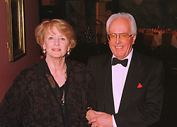 LORD RIX and his wife ELSPET GRAY at a show in London on 7th December 1998.MMS 22