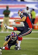 Buffalo Bills kicker Rian Lindell (9) kicks a 49 yard first quarter field goal that gives the Bills a 3-0 lead during the NFL football game against the New York Jets, December 3, 2009 in Toronto, Canada. The Jets won the game 19-13. ©Paul Anthony Spinelli