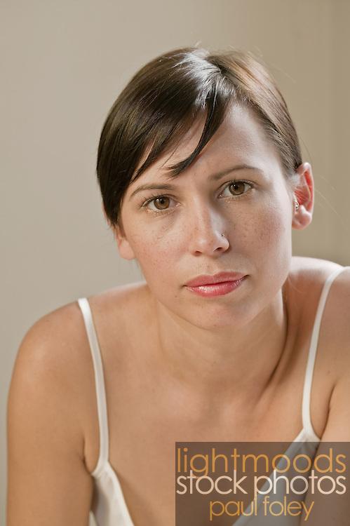 Gen y single female in bedroom