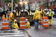 Workers digging a hole on Madison Avenue and 84th street.