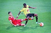 Phoenix' Roly Bonevacia is trip tackled by Adelaide United's Marcelo Carrusca during the Round 22 A-League football match - Wellington Phoenix V Adelaide United at Westpac Stadium, Wellington. Saturday 5th March 2016. Copyright Photo.: Grant Down / www.photosport.nz