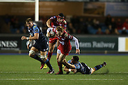 Rhys Patchell of the Scarlets &copy; tries to break the tackle from Steven Shingler &reg; of Cardiff Blues. Guinness Pro12 rugby match, Cardiff Blues v Scarlets at the BT Cardiff Arms Park in Cardiff, South Wales on Friday 28th October 2016.<br /> pic by Andrew Orchard, Andrew Orchard sports photography.