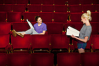 Young women sitting in theatre stalls