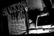 A member of the special tactical division of the Sucre police force conducts a late night  patrol in the Petare slum. 91 percent of crimes go unsolved in Venezuela.