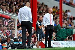 Brentford Manager, Uwe Rosler looks on - Photo mandatory by-line: Patrick Khachfe/JMP - Mobile: 07966 386802 09/08/2014 - SPORT - FOOTBALL - Brentford - Griffin Park - Brentford v Charlton Athletic - Sky Bet Championship - First game of the season