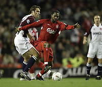 Photo Aidan Ellis.<br /> Liverpool v Middlesbrough<br /> Carling Cup 4th rd.<br /> 10/11/2004.<br /> Liverpool's Salif Daio and Boro's Mark Viduka