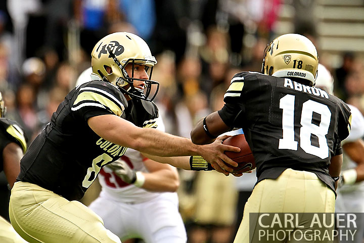 November 3, 2012:  University of Colorado Buffalos quarterback Nick Hirschman (8) hands the ball off to running back Donta Abron (18) during the NCAA Football game between the Stanford Cardinal and the University of Colorado Buffalos at Folsom Field in Boulder, CO