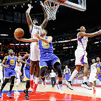 19 November 2015: Golden State Warriors guard Stephen Curry (30) goes for the reverse layup past Los Angeles Clippers guard Wesley Johnson (33) and Los Angeles Clippers center DeAndre Jordan (6) during the Golden State Warriors 124-117 victory over the Los Angeles Clippers, at the Staples Center, Los Angeles, California, USA.