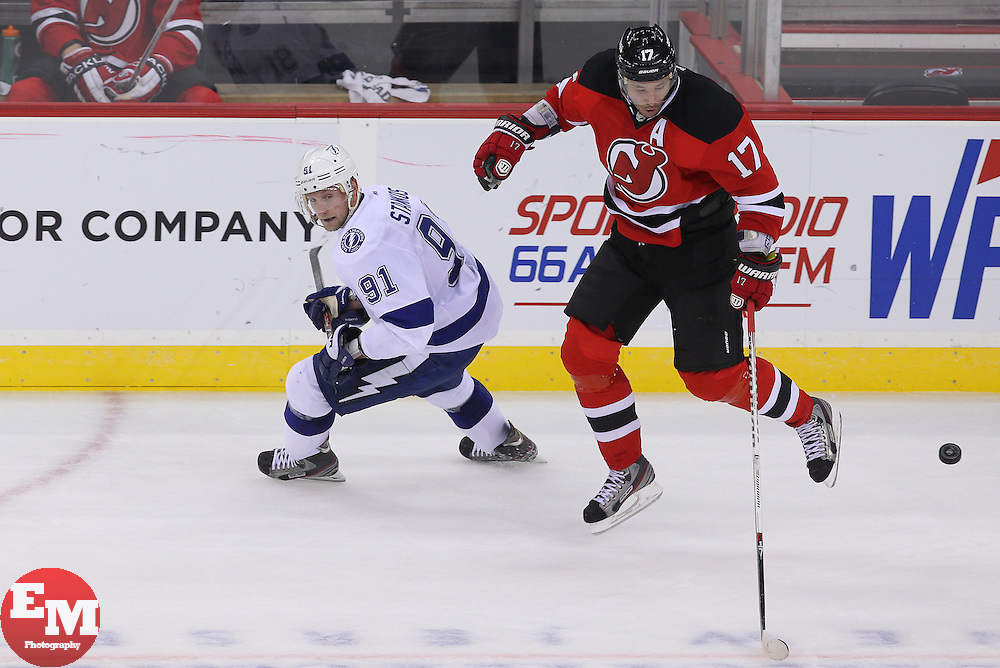 Feb 7, 2013; Newark, NJ, USA; New Jersey Devils right wing Ilya Kovalchuk (17) jumps in the air to avoid a hit by Tampa Bay Lightning center Steven Stamkos (91) during the third period at the Prudential Center. The Devils defeated the Lightning 4-2.