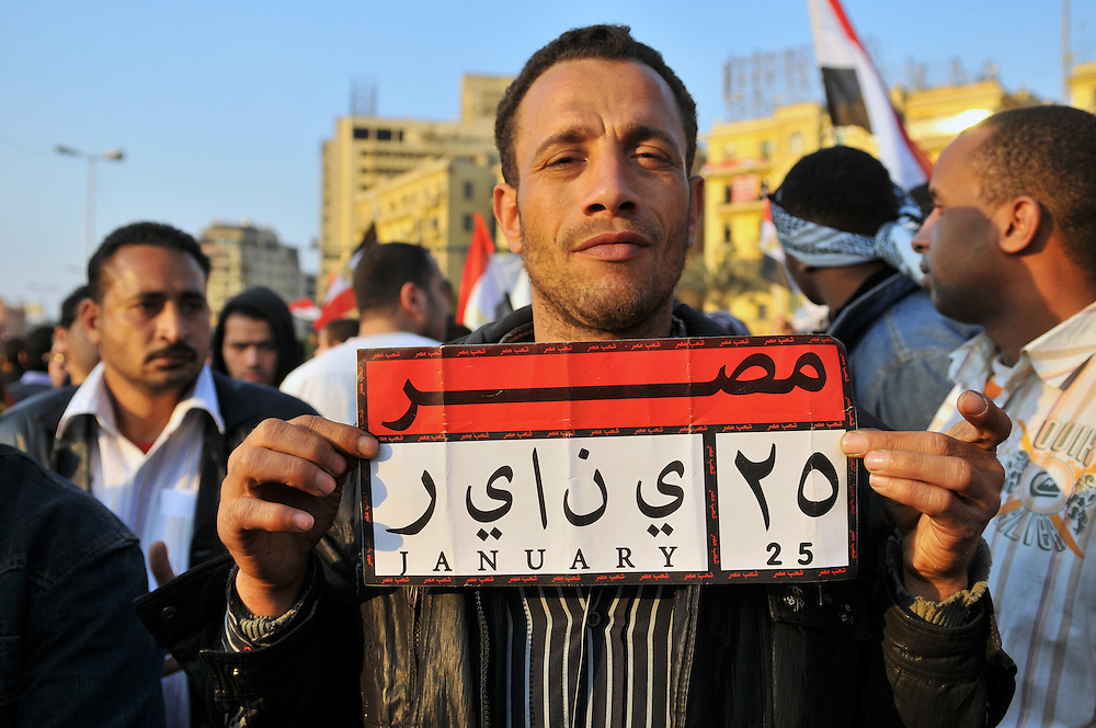 The day after Hosni Mubarak resigned as Egypt's president, Egyptians filled Cairo's Tahrir Square to celebrate their victory. January 25 marks the start of the protests which 18 days later resulted in Mubarak's departure. This popular sign commemorating the historic day is modeled after an Egyptian license plate. (Cairo, Egypt - February 12, 2011)