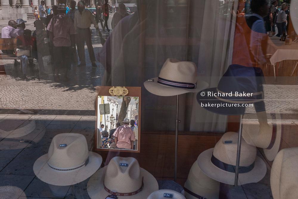 Hats on sale in the window of Chapelaria Azevedo Rua on Rossio Praca Dom Pedro IV, in Lisbon, Portugal.