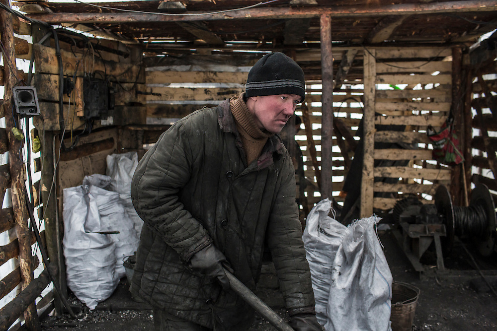 SNEZHNE, UKRAINE - JANUARY 25, 2015: Dmitry Kontratenko at the small private coal mine where he works in Snezhne, Ukraine. The mine produces approximately 15 tons of coal per day with a crew of four men. CREDIT: Brendan Hoffman for The New York Times