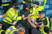 A fan is led away in handcuffs during the Europa League match between Rangers FC and Feyenoord Rotterdam at Ibrox Stadium, Glasgow, Scotland on 19 September 2019.