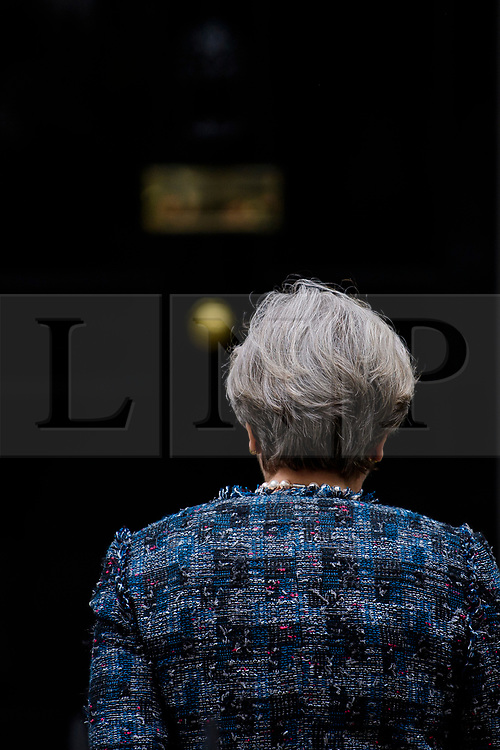 © Licensed to London News Pictures. 03/05/2017. London, UK. The back of British prime minister THERESA MAY's head as she return to 10 Downing Street, after delivering a statement outside Downing Street in London after a meeting with The Queen to dissolve parliament ahead of an election on June 8. Photo credit: Ben Cawthra/LNP