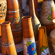 Pots and vases on display at a shop in Spain.