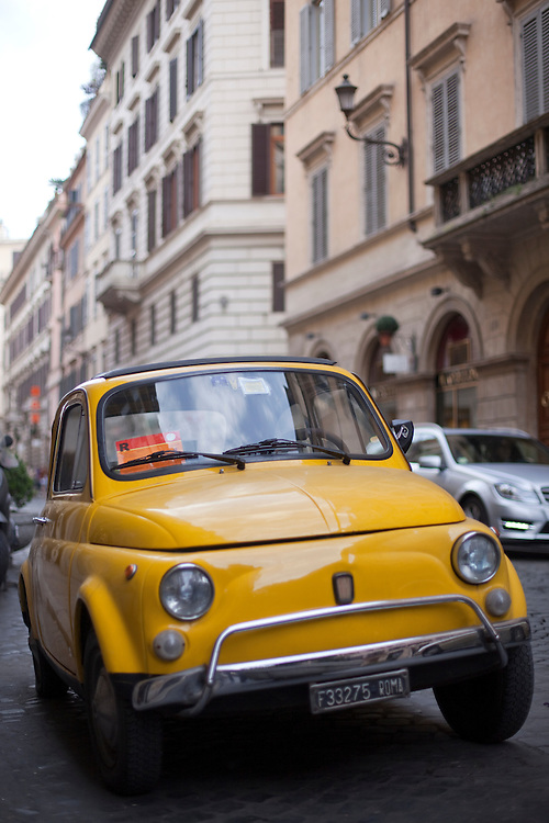 Classic Fiat 500 on a stret of Rome, Italy.