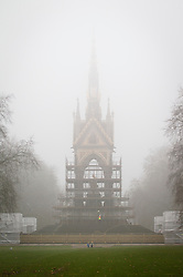 © Licensed to London News Pictures. 08/03/2013. London, UK. The Albert Memorial, currently undergoing renovation work, is seen almost disappearing into early morning fog in Hyde Park London today (08/03/2013). Photo credit: Matt Cetti-Roberts/LNP