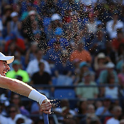 The sweat flies off Andy Murray, Great Britain, in action against Kevin Anderson, South Africa, in the late afternoon match on Louis Armstrong Stadium during the US Open Tennis Tournament, Flushing, New York, USA. 7th September 2015. Photo Tim Clayton