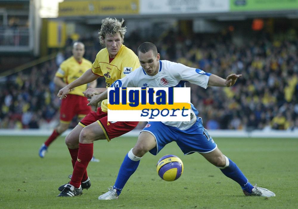 Photo: Marc Atkins.<br />Watford v Middlesbrough. The Barclays Premiership. 04/11/2006. Darius Henderson (L) of Watford & Emanuel Pogatetz of Boro in action.