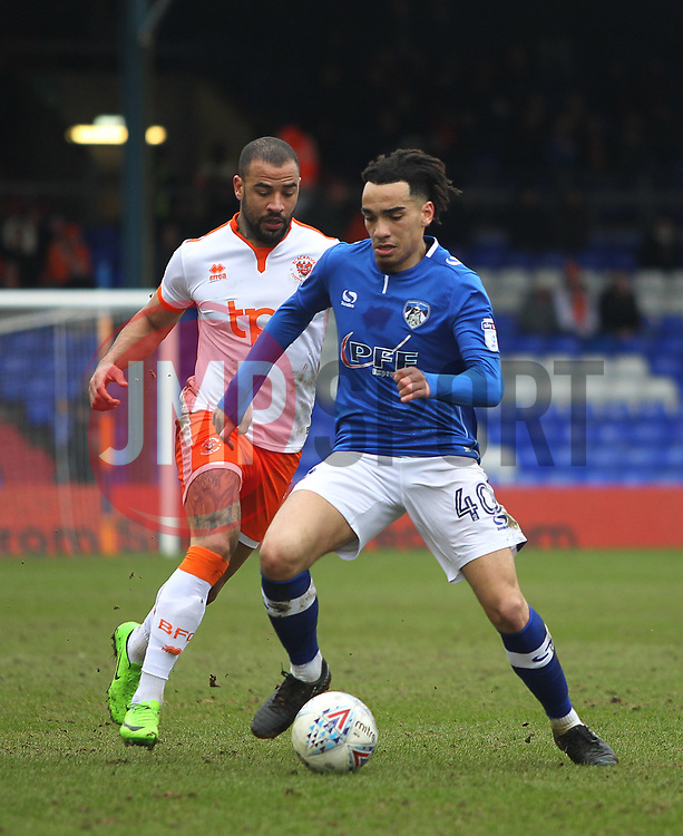 Kyle Vassell of Blackpool (L) and Kean Bryan of Oldham Athletic in action - Mandatory by-line: Jack Phillips/JMP - 02/04/2018 - FOOTBALL - Sportsdirect.com Park - Oldham, England - Oldham Athletic v Blackpool - Football League One