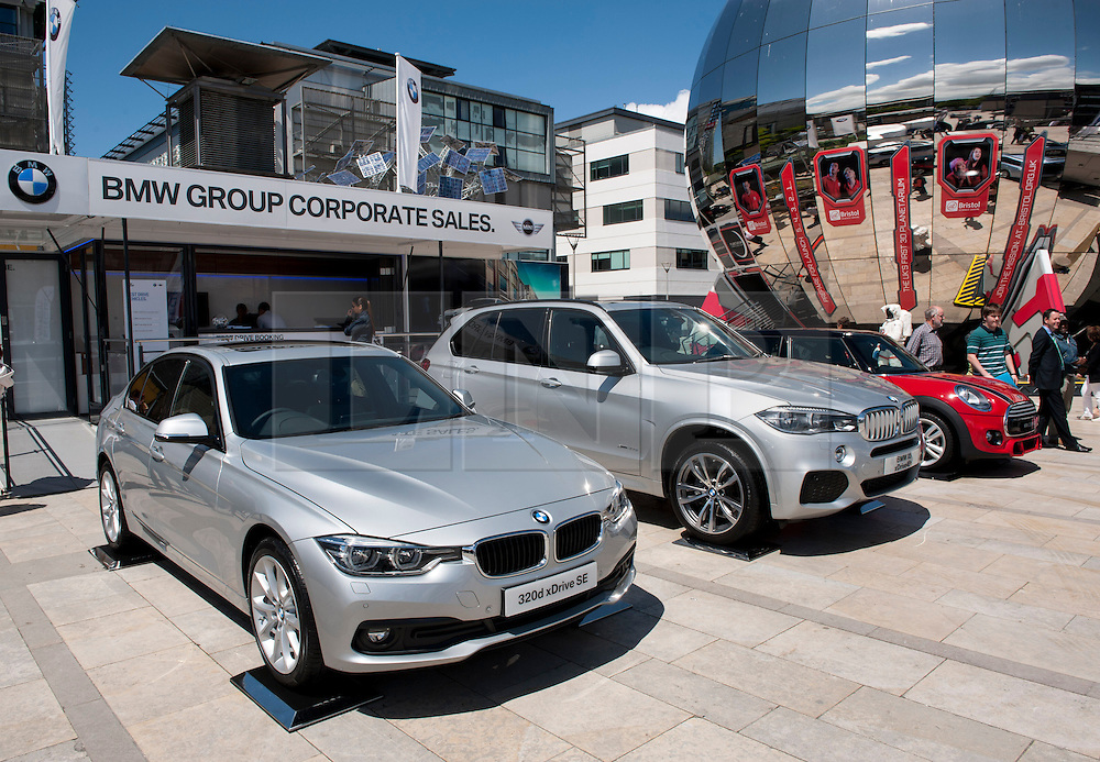 © Licensed to London News Pictures. 06/06/2015. Bristol, UK.  Two new BMW's due later this year, left-right: a BMW 320d xDrive SE and a BMW X5 xDrive 40e, at a display of electric, hybrid, and low emission vehicles at Bristol's Millennium Square sponsored by EDF energy. The cars are engineered to produce no or low emissions and pollution to reduce the impact of transport on the environment.  Photo credit : Simon Chapman/LNP
