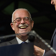 Congressman, Gerry Connolly laughs as Don Beyer, Democratic candidate for the 8th District (VA) hands him the microphone, during a Democrat get out the vote (GOTV) rally at Market Square in Old Town Alexandria, VA, on  Monday, November 3, 2014, the day before Election Day.  John Boal Photography