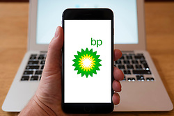 Using iPhone smartphone to display logo of BP oil and gas company