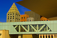 The Frederic C. Hamilton Building of the Denver Art Museum (on right) and bridge (which connects to the Northern Building of the museum) with the Denver Central Library in background,  Civic Center Cultural Complex, Denver, Colorado, USA