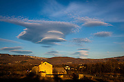 Lenticular Clouds near Puigcerda, on the Spain/France border of Catalonia. Clouds like these more or less stationary and lens-shaped,  forming in the lower atmosphere, usually perpendicular to wind direction. Where I took this image was quite cold - the other side of the mountains, warm air was blowing in from the Mediterranean Sea - with the combination of both, the vapour was likely formed.