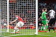 Laurent Koscielny of Arsenal collects the ball after scoring the opening goal during the Barclays Premier League match at the Emirates Stadium, London<br /> Picture by David Horn/Focus Images Ltd +44 7545 970036<br /> 28/04/2014