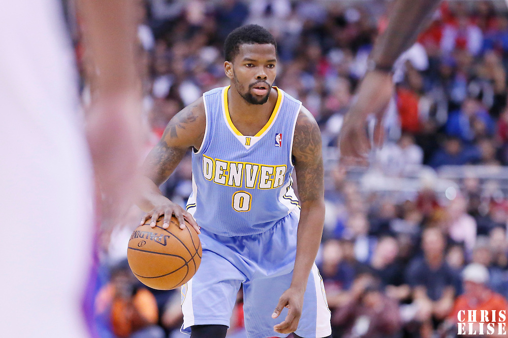 15 April 2014: Denver Nuggets guard Aaron Brooks (0) dribbles during the Los Angeles Clippers 117-105 victory over the Denver Nuggets at the Staples Center, Los Angeles, California, USA.