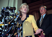 Republican Rep. Jennifer Dunn of Washington speaks to the media as Majority leader Dick Army looks on November 18, 1998 in Washington, DC. Majority leader Dick Army, a Texan who has been majority leader since the Republicans gained control of the House in the 1994 elections, defeated Largent and Dunn after three ballot.