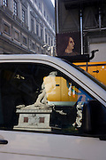 The reflections of renaissance statues of Hercules and David are seen reflected in builder's van parked adjecent to the Piazza della Signoria in Florence's Piazza degli Uffizi. A 16th century portrait of a medieval nobleman or official rises above the vehicle and a yellow compressor is seen behind. Top left is the Uffizi art gallery that houses many national treasures but this is a scene of an urban dystopia where construction forever interferes with the cultural idyll that visitors from around the world come to see. The white marble sculpture Hercules and Cacus is to the right of the entrance of the Palazzo Vecchio in the Piazza della Signoria, Florence, Italy. The Hercules and Cacus is a work by the Florentine artist Baccio Bandinelli (1525-1534) and the David is Michelangelo's replica, now also in the Uffizi.