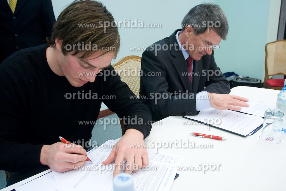 Rok Perko (right Stane Valant) at press conference when he has signed a contract with IOC and OKS for 16 months long sponsorship (1500 $ monthly) till Olympic games in Vancouver 2010, on December 22, 2008, Grand hotel Union, Ljubljana, Slovenia. (Photo by Vid Ponikvar / SportIda).