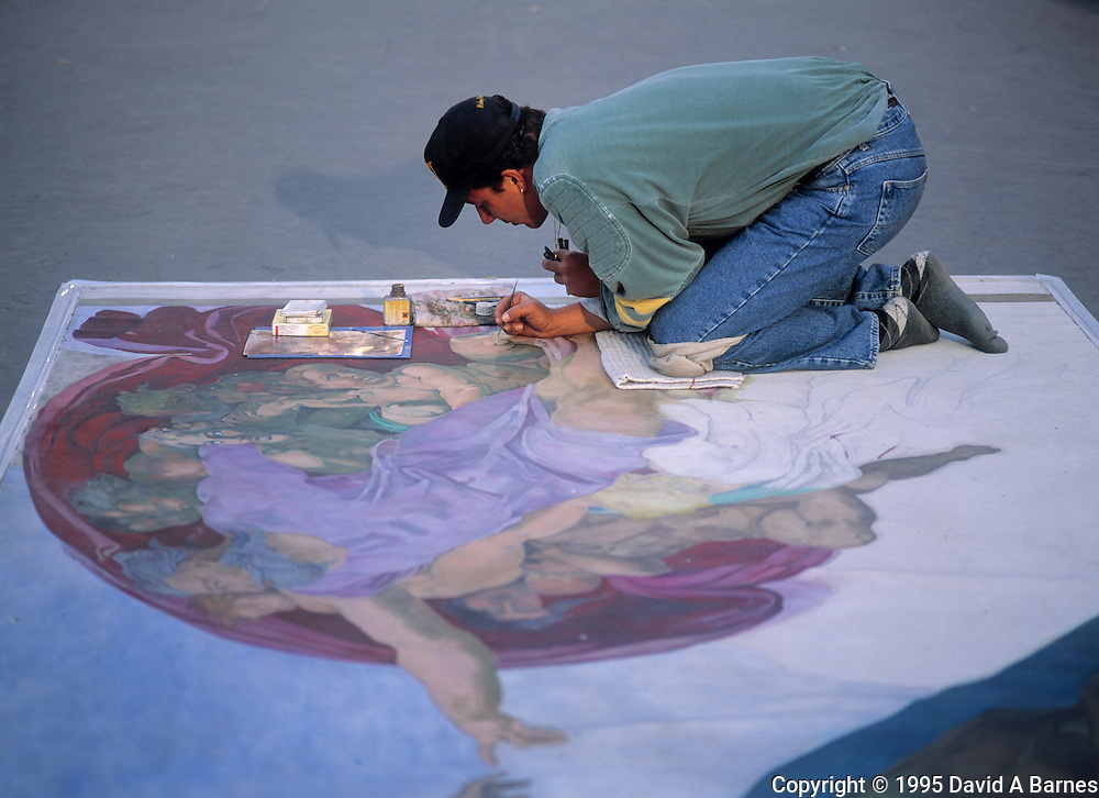 Sidewalk artist recreating section from Michelangelo's Sixtine Chapel, Paris, France
