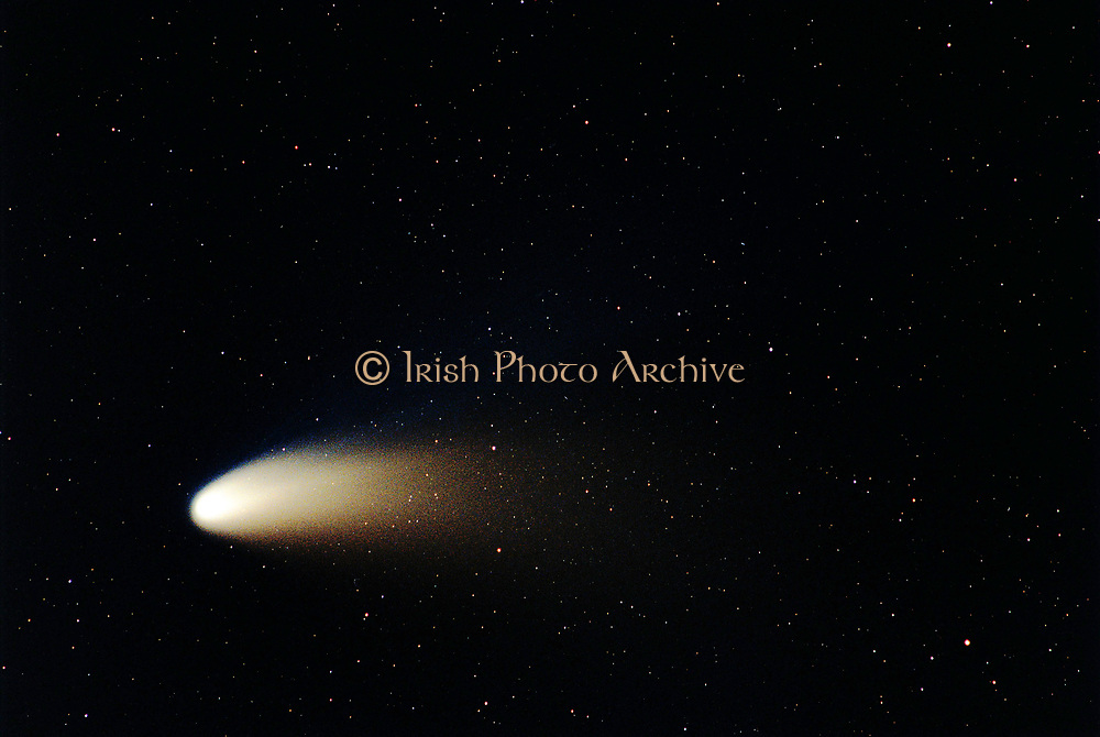 The Dust and Ion Tails of Comet Hale-Bopp.  In 1997, Comet Hale-Bopp's intrinsic brightness exceeded any comet since 1811. Since it peaked on the other side of the Earth's orbit, however, the comet appeared only brighter than any comet in two decades. Visible above are the two tails shed by Comet Hale-Bopp. The blue ion tail is composed of ionized gas molecules, of which carbon monoxide particularly glows blue when reacquiring electrons. This tail is created by the particles from the fast solar wind interacting with gas from the comet's head. The blue ion tail points directly away from the Sun.