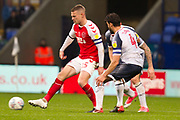 Fleetwood Town midfielder Paul Coutts challenged by Bolton Wanderers midfielder Jason Lowe during the EFL Sky Bet League 1 match between Bolton Wanderers and Fleetwood Town at the University of  Bolton Stadium, Bolton, England on 2 November 2019.