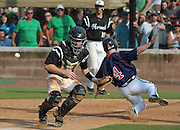 Milton courtesy runner Andrew Wood scores past Roswell catcher Drew Davis for the go-ahead run on the hit by Dalon Farkas with 2-out in the eighth inning of their GHSA AAAAAA State Baseball Championship game, Monday, May 27, 2013, in Milton, Ga.   David Tulis/dtulis@gmail.com