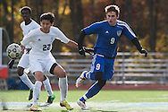 Mount Anthony's Carter Bentley (9) and Burlington's Jonas Lobe (22) battle for the ball during the quarterfinal boys soccer game between Mount Anthony and Burlington at Buck Hard Field on Friday afternoon October 23, 2015 in Burlington. (BRIAN JENKINS/ for the FREE PRESS)